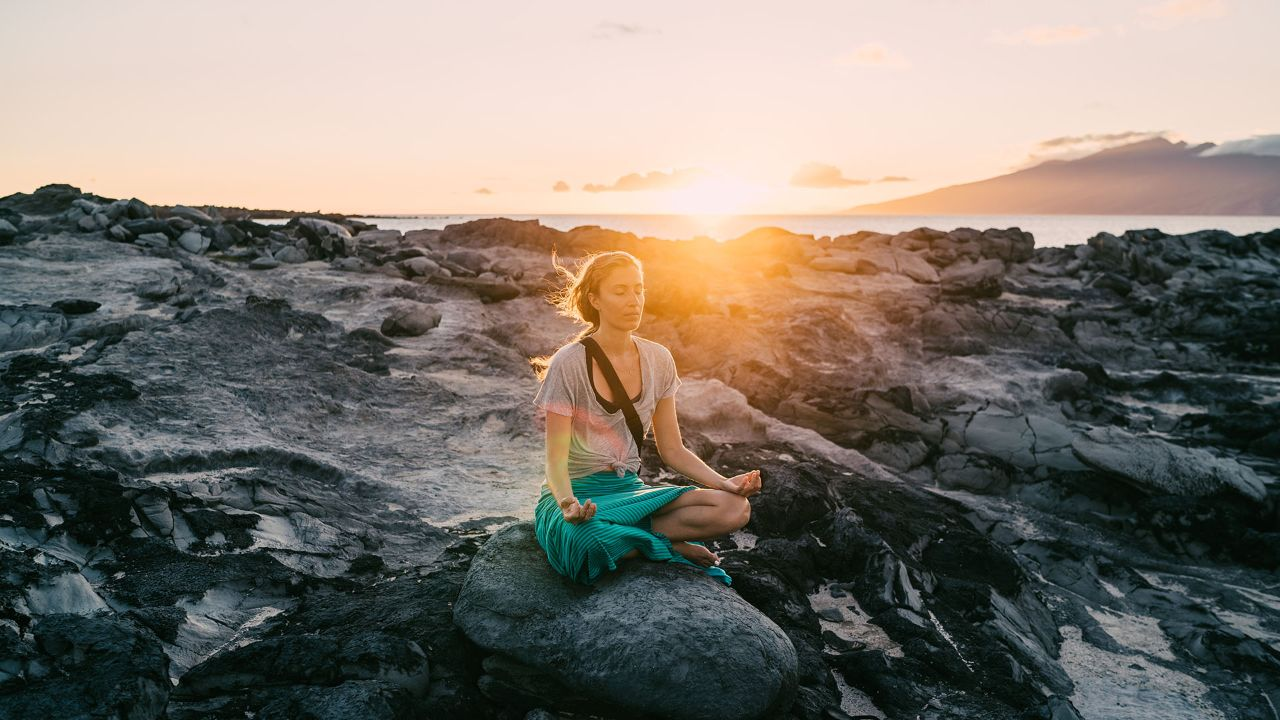 Maria Russo meditates on the volcanic rocks at Dragon's Teeth.