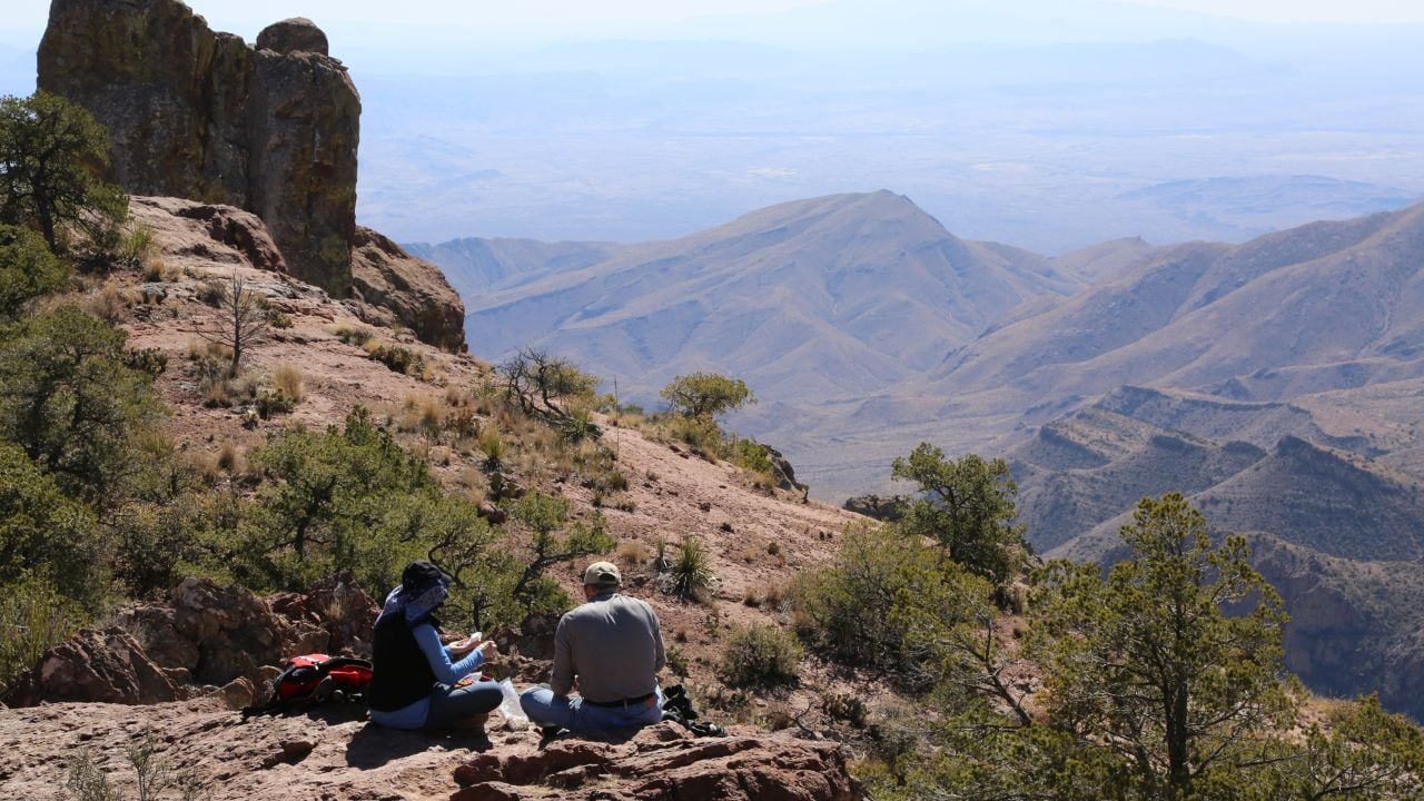 Hikers enjoy a picnic at the end of the Lost Mine Trail Hike.