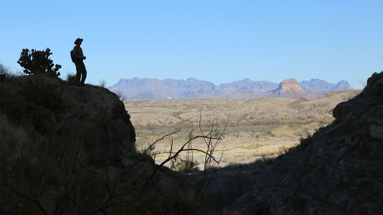 A hiker looks down on the Rio Grande River in the Santa Elena Canyon.