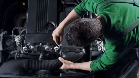 Technician working on an engine