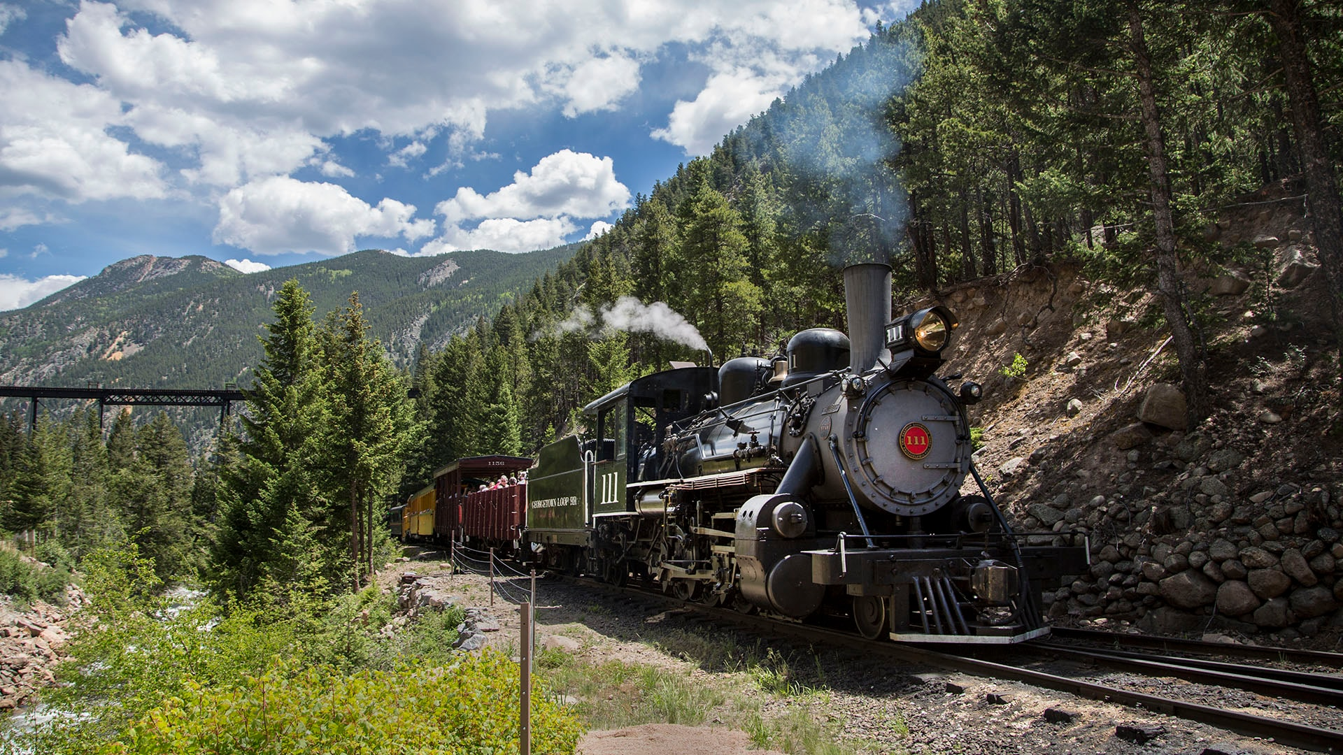 The Georgetown Loop Railroad was completed in 1884. The train runs between Georgetown and Silver Plume, Colorado.