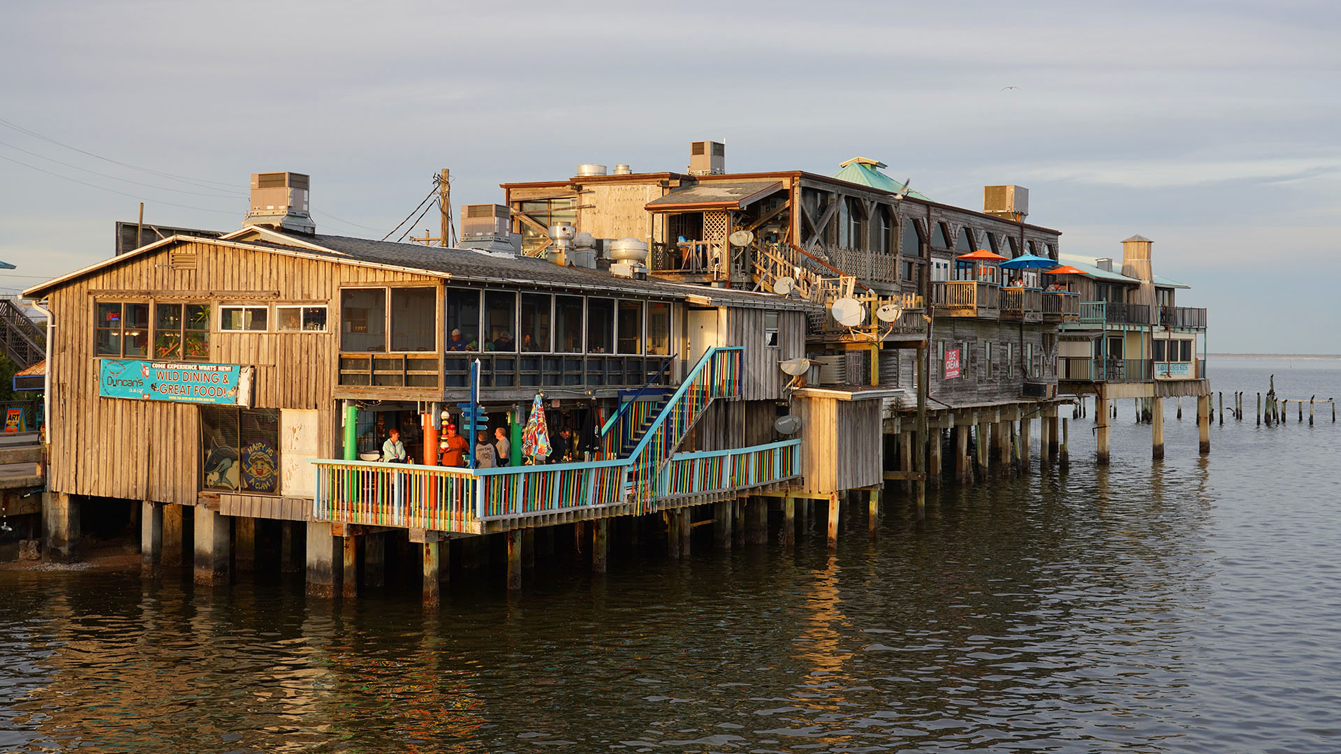 Waterfront buildings in historic downtown Cedar Key as seen from the fishing pier.