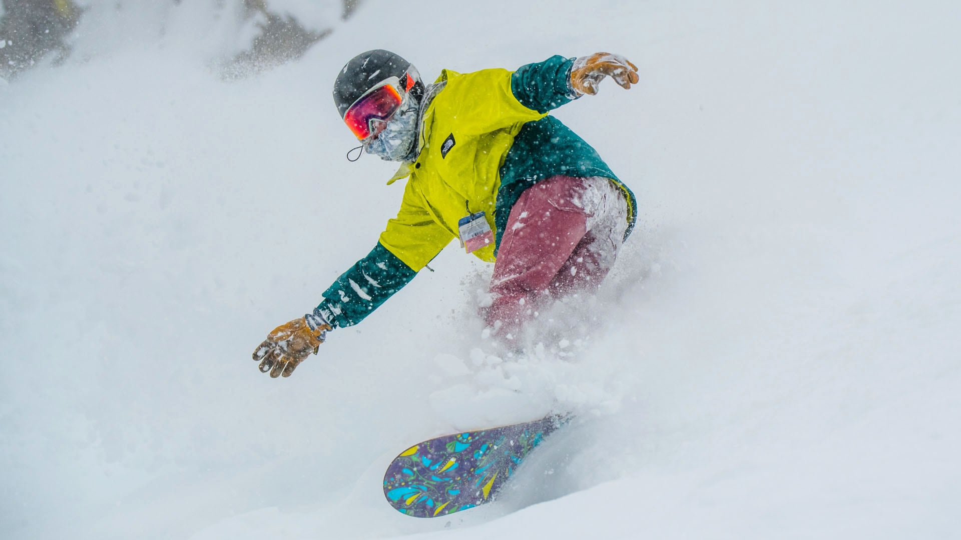 A snowboarder rides fresh snow at Lost Trail Powder Mountain.
