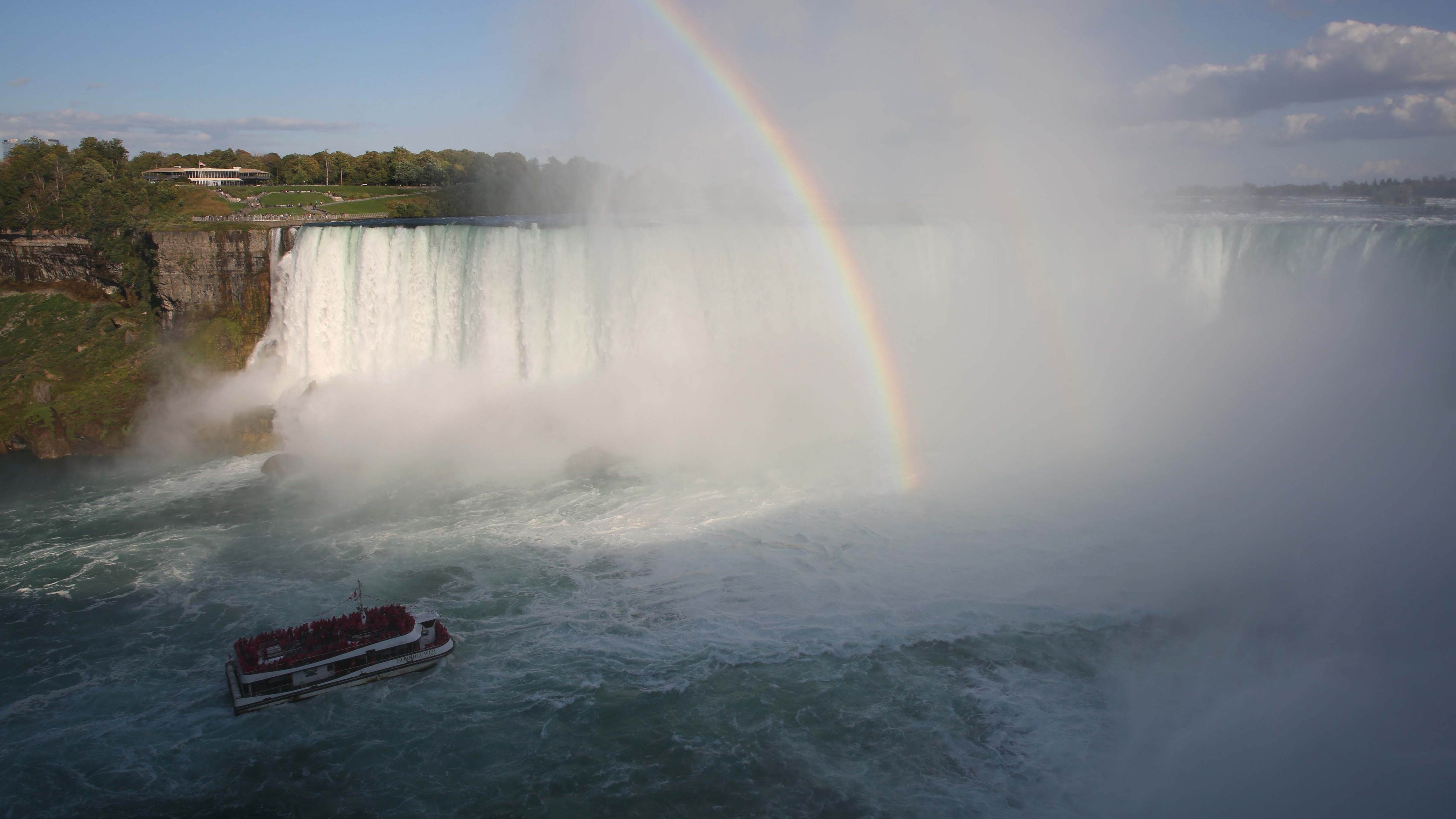 A boat operated by Hornblower Niagara Cruises ventures to the edge of Horseshoe Falls.