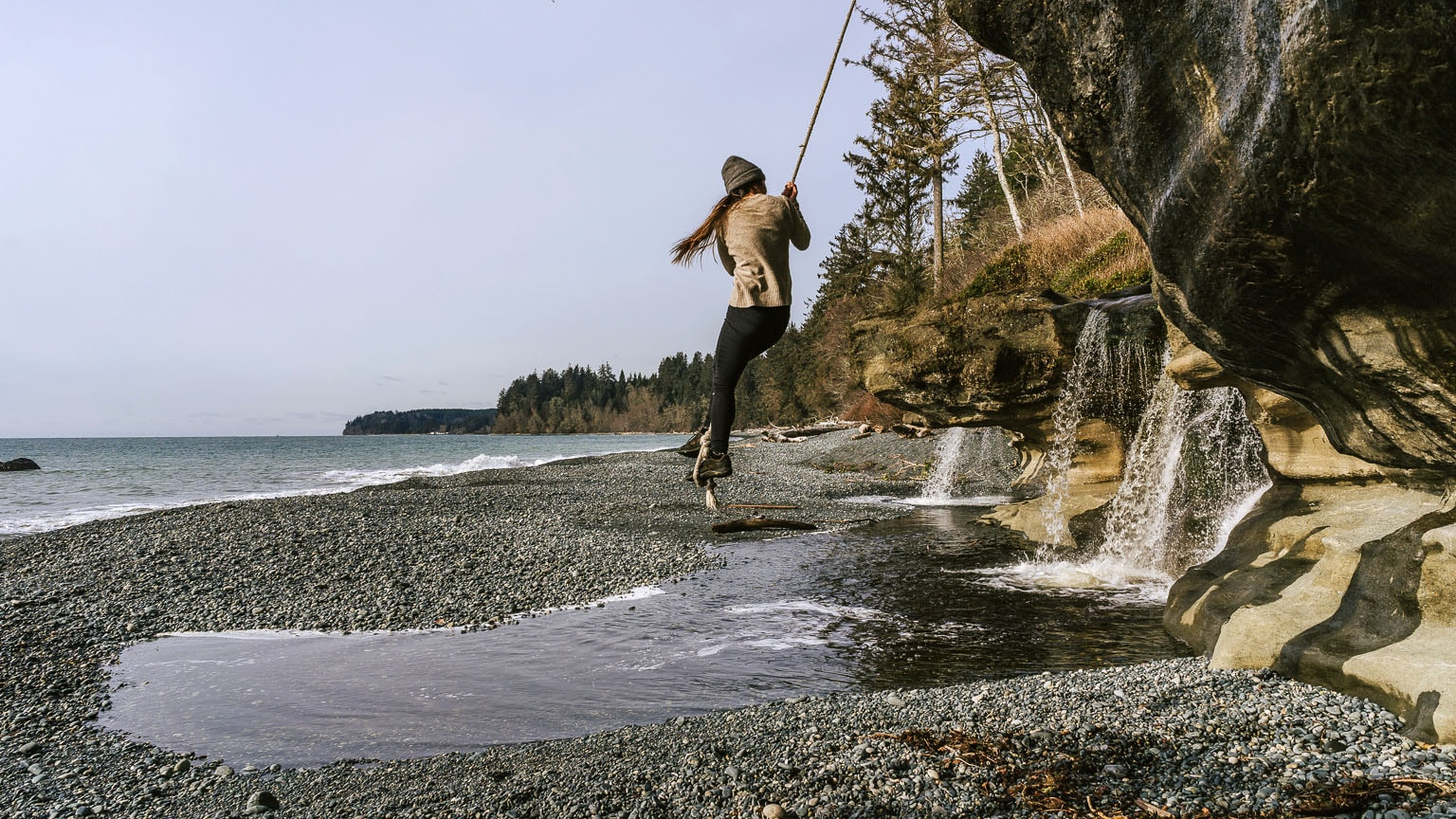 The author swings on a rope at Sandcut Beach.