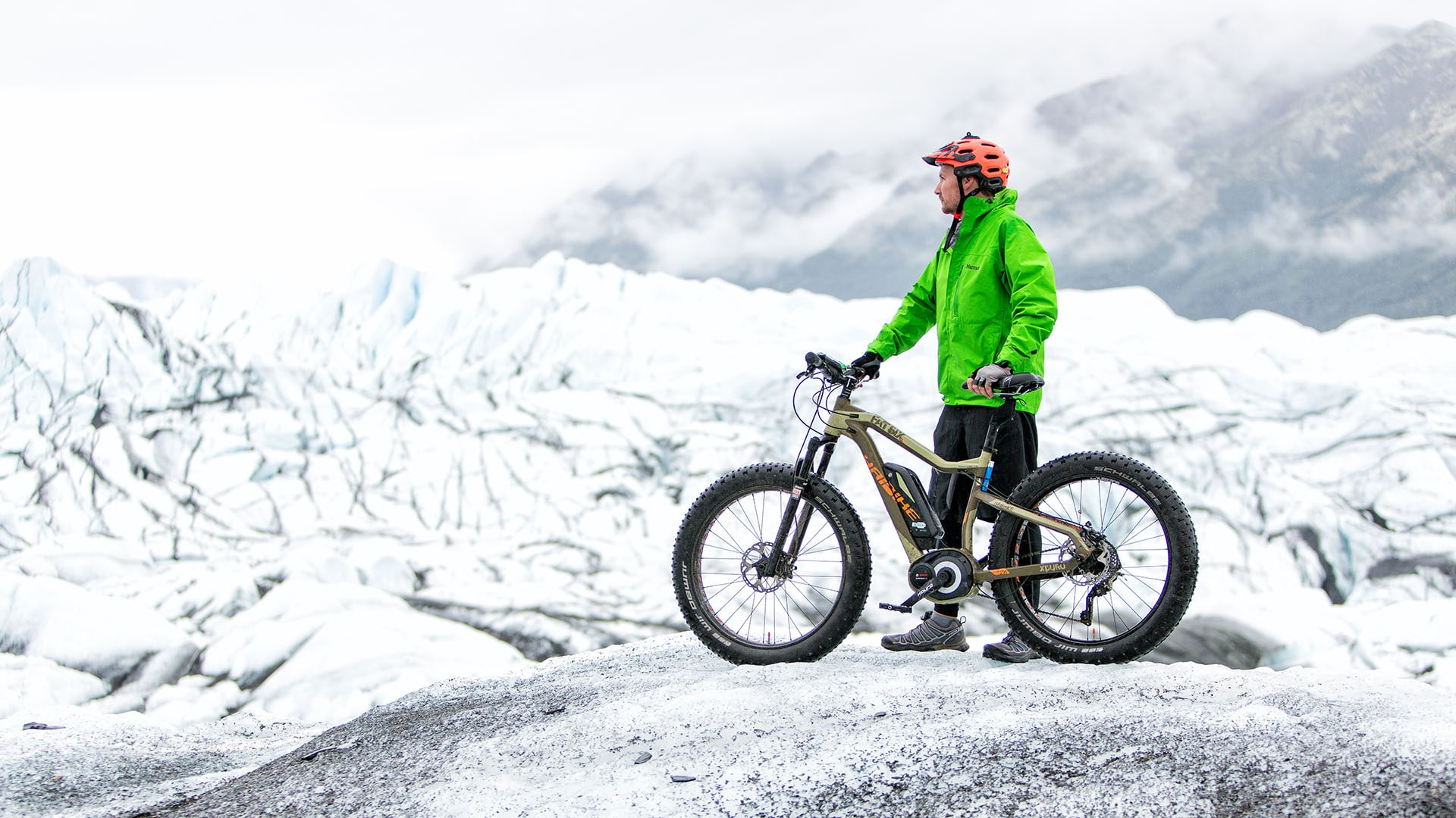 A mountain biker enjoys the view at Matanuska Glacier in Alaska.